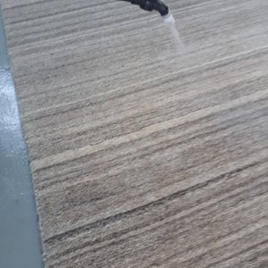 Applying a pre treatment spray to a wool rug before cleaning