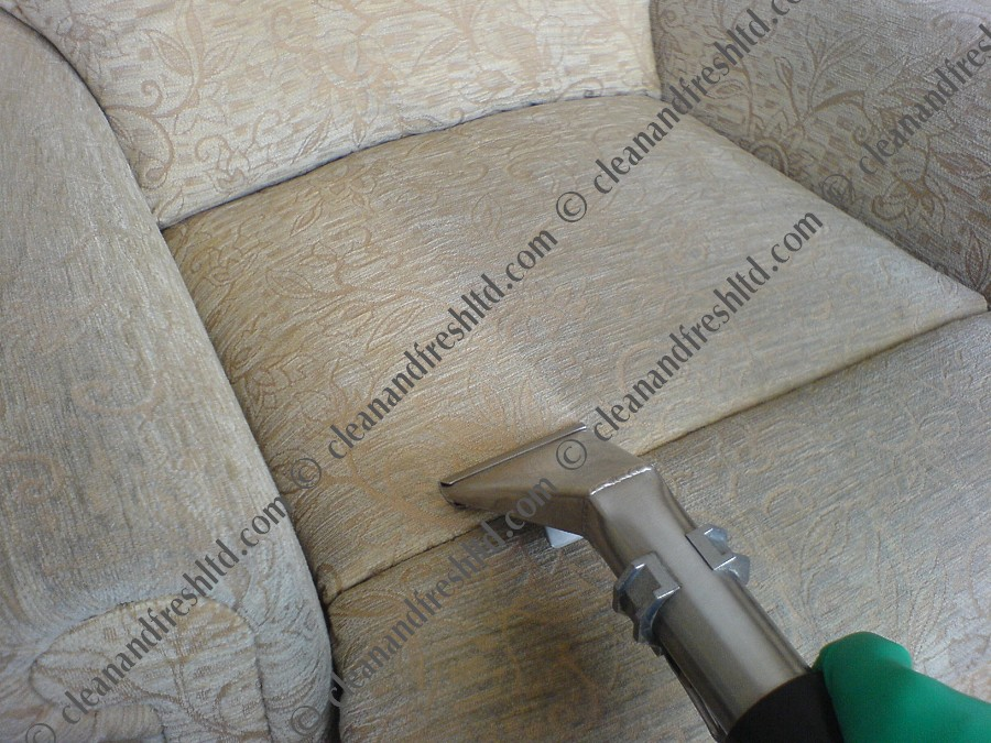 Upholstery cleaning an armchair