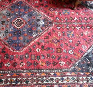 An Iranian wool rug that had been cleaned with a dry compound due to the dyes being likely to run if water was used