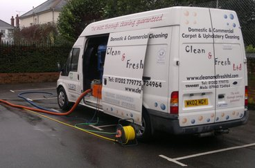 Our truck mounted carpet cleaning machine cleaning carpets in a commercial building
