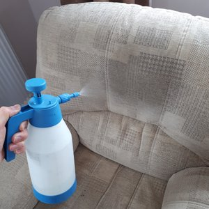 Using a pump sprayer to apply pre conditioning treatment to an armchair