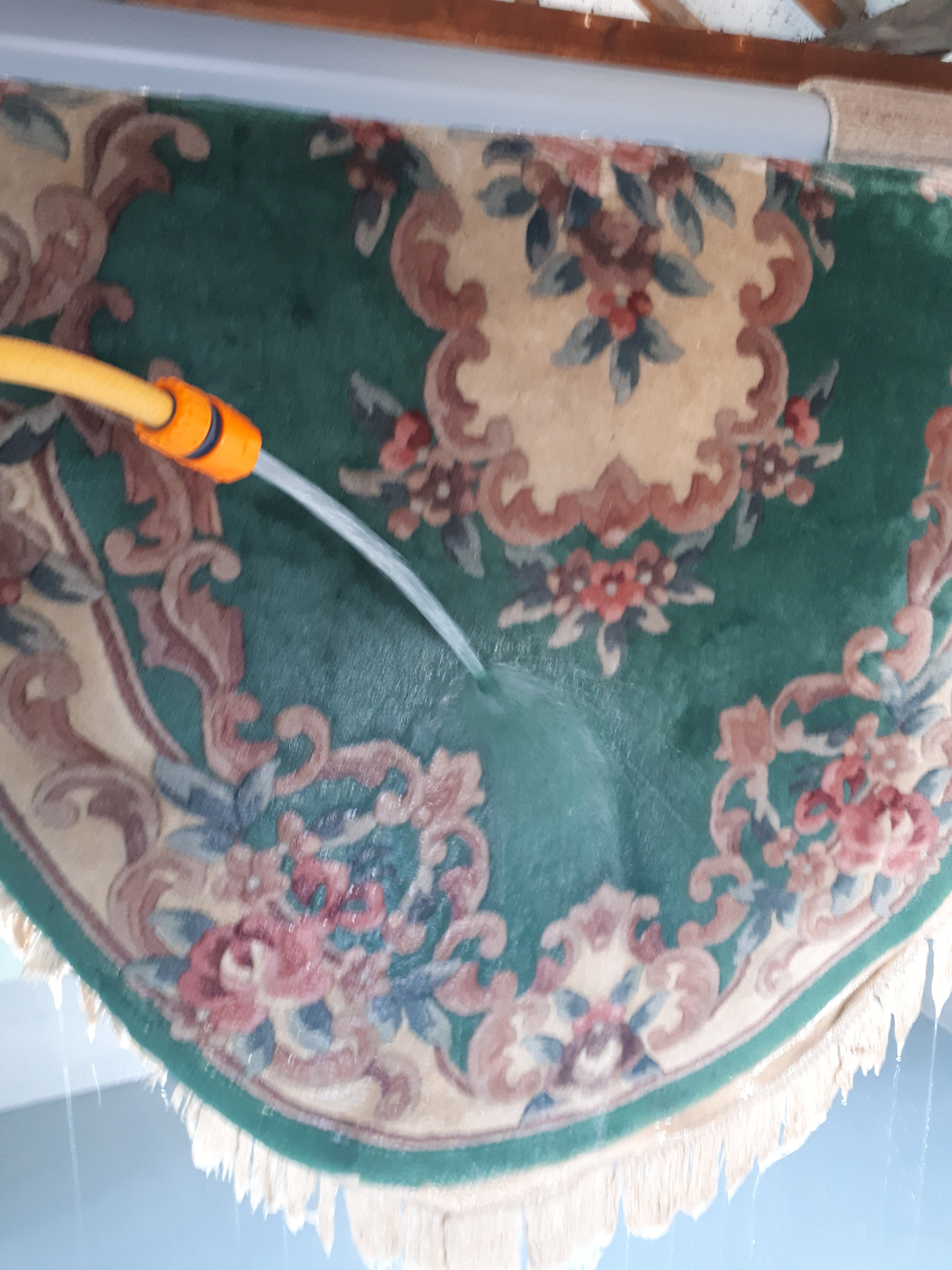 A wool rug having all the cleaning products washed out of it with a fresh water rinse