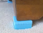 Styrofoam block under the furniture leg to prevent it touching the carpet during drying